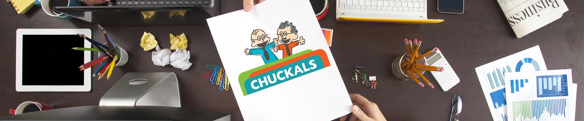Chuckals hero image desk with Chuckals logo on paper