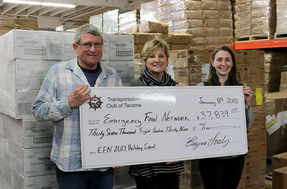 Emergency Food Network staff holding a check